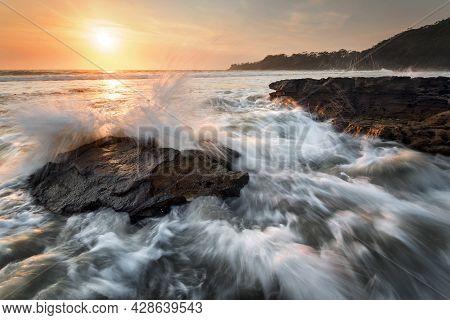 Waves Splashing Around Rocks At Sunrise On Nsw South Coast