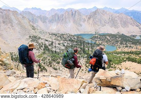 July 27, 2021 In Kings Canyon National Park:  Backpackers Hiking At Karseage Pass Overlooking Alpine