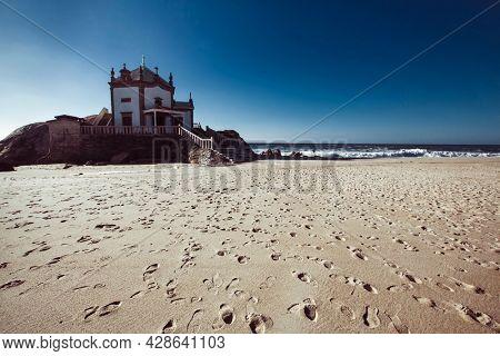 View of the Chapel Senhor da Pedra, Miramar beach, Portugal.