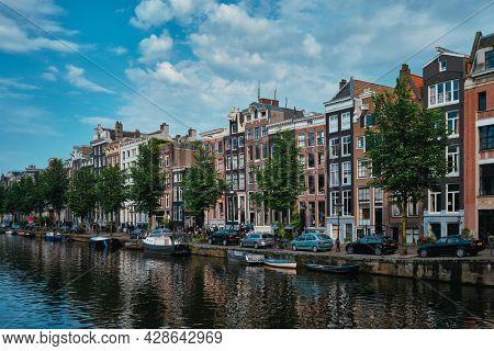 Singel canal in Amsterdam with old houses. Amsterdam, Netherlands