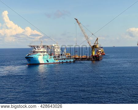 Supply Boat Transfer Cargo To Oil And Gas Industry Is Moving Offshore Accommodation Barge To Serve A