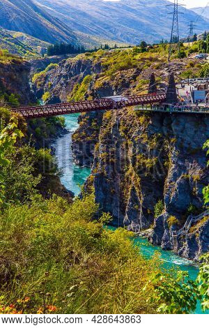 Extreme sports - bungee jumping into the abyss upside down. New Zealand. River and bridge Kawarau between Queenstown and the town of Cromwell. The concept of extreme, active and photo tourism