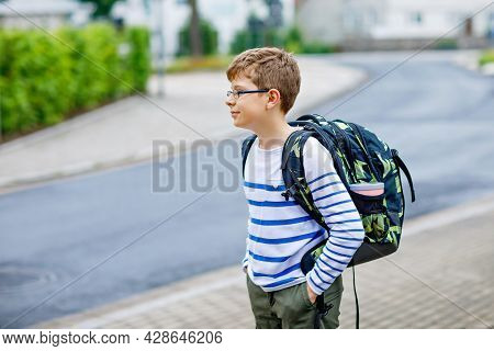 Happy Little Kid Boy With Satchel And Eyeglasses. Schoolkid Wearing Glasses On The Way To Middle Or