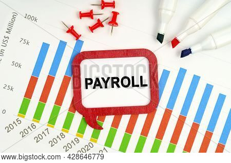 Business And Economy Concept. There Are Markers, Charts And A Sign On The Table - Payroll