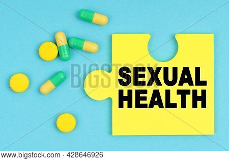 Medicine And Health Concept. On A Blue Background, There Are Pills And A Puzzle With The Inscription