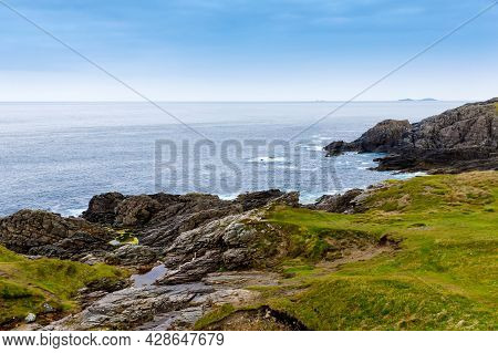 Rugged Landscape At Malin Head, County Donegal, Ireland. Rough Beach With Cliffs, Green Rocky Land W