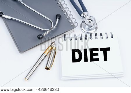 Medicine And Health Concept. On The Table Are A Stethoscope, A Pen And A Notebook With The Inscripti