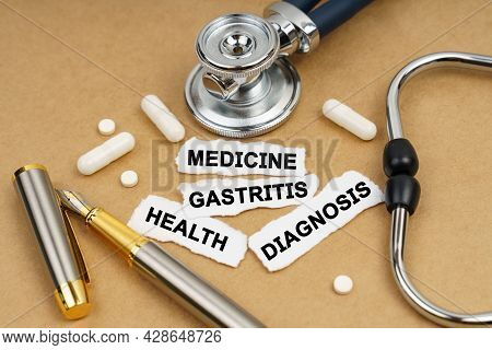 Medicine And Health Concept. On The Table Is A Stethoscope, Pills And Pieces Of Paper With Inscripti