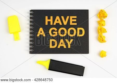 Business Concept. On A White Background Lies A Marker, An Exclamation Mark Made Of Paper And A Noteb