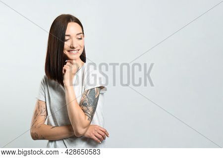 Portrait Of Pretty Young Woman With Gorgeous Chestnut Hair And Charming Smile On Light Background, S