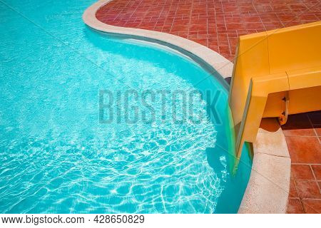 Stylishly Interesting Water Slide In The Pool Near The Sea On Nature Background