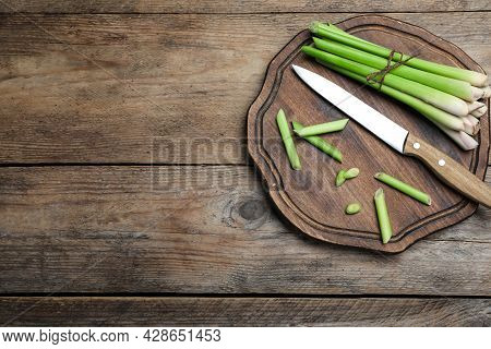 Fresh Lemongrass, Knife And Cutting Board On Wooden Table, Top View. Space For Text