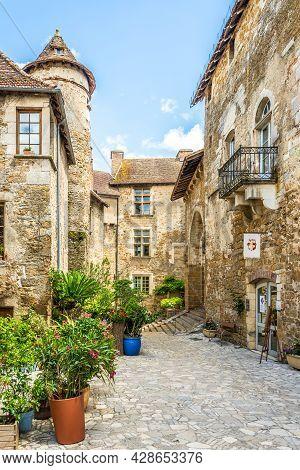 Carennac, France - June 23,2021 - At The Courtyard Of Monastery Near Church Of Saint Pierre In Caren
