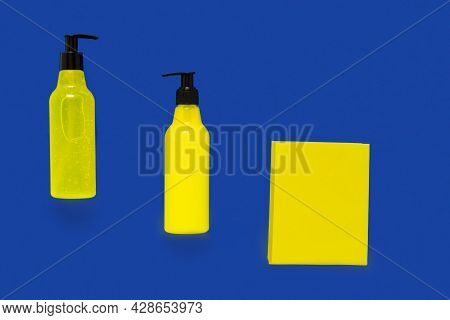Bright, Summer Cosmetic Bottles Of Yellow Color On A White Background, Top View. Packaging For Brand