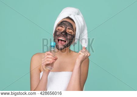 Excited Amazed Beautiful Woman With Cosmetic Mud Facial Procedure, Spa Health Concept. Skin Care Bea