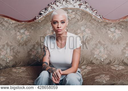 Millenial Young Woman With Short Blonde Hair Portrait Sitting On Vintage Sofa
