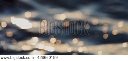 Water Waves With Golden Bokeh. Natural Blurred Abstract Water Background.