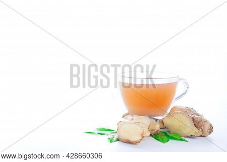 Closeup Hot Ginger Tea In Glass Cup With Fresh Organic Ginger Root Isolated On White Background, Cop