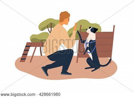 Trainer Teaching Dog At Agility Courses. High Five Trick Of Obedient Doggy With Raised Paw. Pet Owne