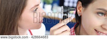 Otorhinolaryngologist Examines Patient Ear With Otoscope Closeup