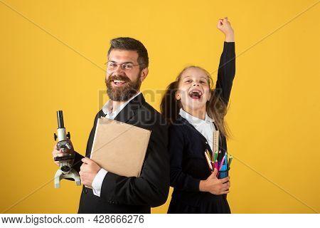 Cheerful Smiling Little Girl In School Uniform Having Fun In Studio. Portrait Of Amazed Excited Happ