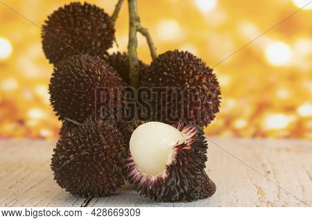 A Bunch Of The Local Fruits Called Pulasan With One Peeled Fruit, A Tropical Fruit From Soapberry Fa