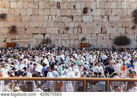 JERUSALEM, ISRAEL - NOVEMBER 16, 2011: The Western Wall - place of faith and pilgrimage for Jews around the world. Great religious Jewish holiday. Jerusalem, the Temple Mount