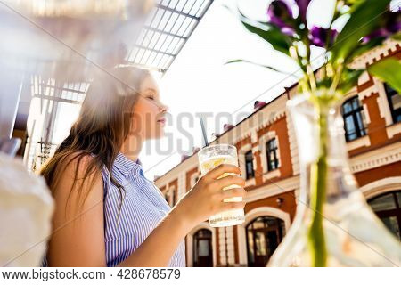 Young Woman Drink Lemonade In Summer Cafe.