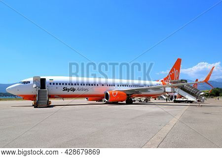 The Plane Of Ukrainian Low Cost Airline Sky Up Is On The Runway At Tivat International Airport. The