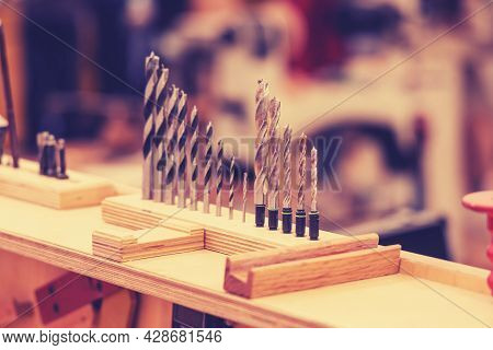 Wood Drills In A Carpentry Workshop. Carpentry Tools For Woodworking
