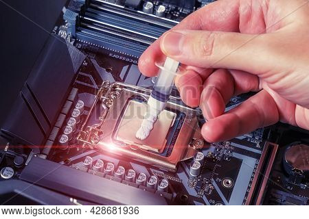 A Technician Applies White Thermal Paste To The Cpu. Installing A Cooler On A Pc Processor. Assembli
