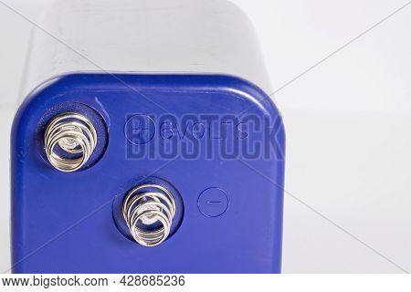 Zinc Chloride 6 Volt Battery Against A Plain Background