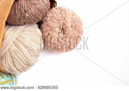 Balls Of Woolen Yarn Of Different Colors And Knitting Needles In A Craft Eco Bag On A White Backgrou