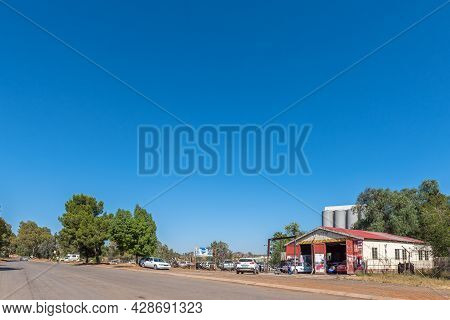 Aliwal North, South Africa - April 23, 2021: A Street Scene, With A Vehicle Body Repair Shop, In Ali