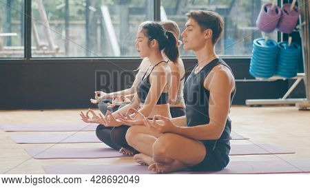 Young Diversity Sporty People Practicing Yoga Lesson With Instructor. Multi Racial Group Of Women An