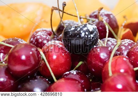 Fruits Apricots, Nectarines, Cherries On A Large Plate On The Table In The Morning During Breakfast,