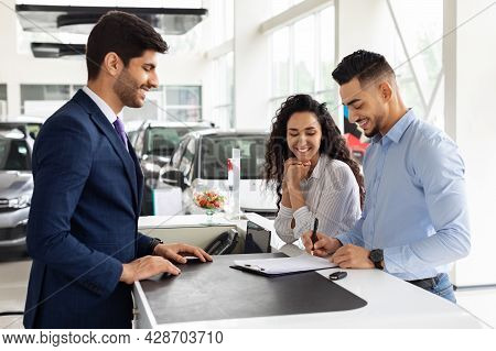 Wealthy Arab Family Buying New Car In Showroom