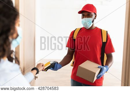 Black Man Holding Pos Terminal Client Paying With Bankcard