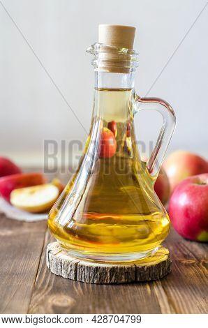 Apple Vinegar In A Glass Bottle. Fermented Fruit Cider Organic Apples Wooden Background Side View He