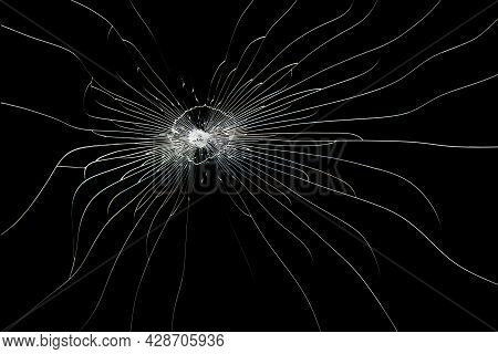 Cracked Line On Broken Glass Isolated On Black Background. The Texture Of The Impact On The Glass.