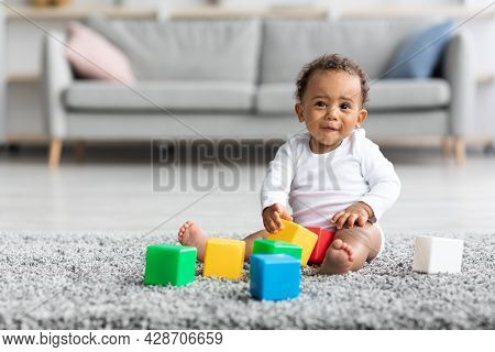 Development Games For Babies. Cute African-american Infant Child Playing With Building Blocks
