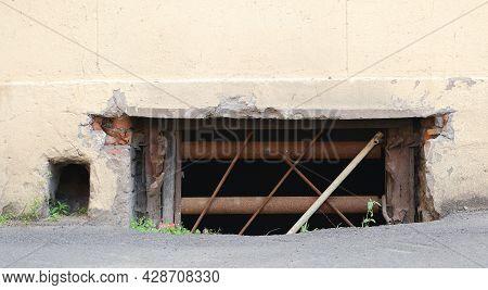 A Basement Window With A Metal Barrier