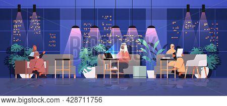 Arab Businesspeople Working In Creative Open Space Arabic Business People Team In Night Dark Office