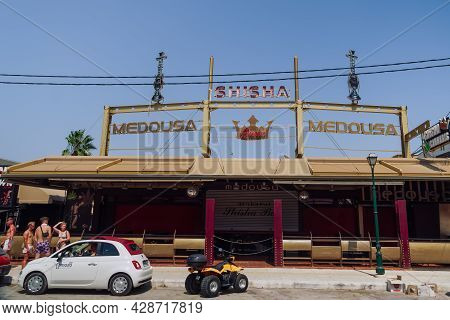 Zakynthos, Greece - July 9 2021: Nightclub Entrance Exterior With Overhead Sign In Laganas. Day View
