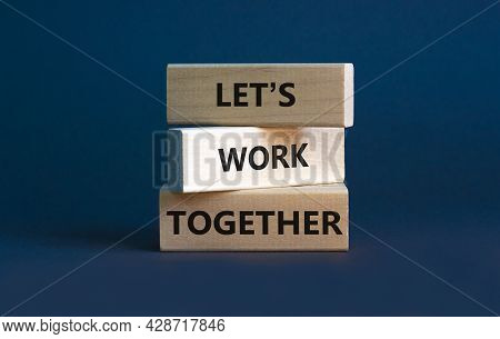 Work Together Symbol. Wooden Blocks With Words Let Is Work Together On Beautiful Grey Background. Bu