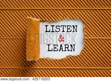 Listen And Learn Symbol. Words 'listen And Learn' Appearing Behind Torn Brown Paper. Beautiful Brown