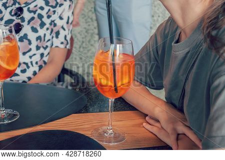 Friends On Summer Vacations Drinking Cocktails. Two Woman Spend Free Time In Local Bar.