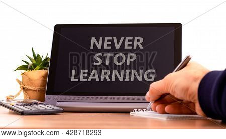 Never Stop Learning Symbol. Tablet With Words 'never Stop Learning'. Businessman Holds Pen, House Pl