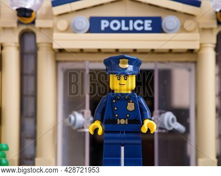 Tambov, Russian Federation - July 05, 2021 Lego Police Officer Standing Outside In Front Of Police S