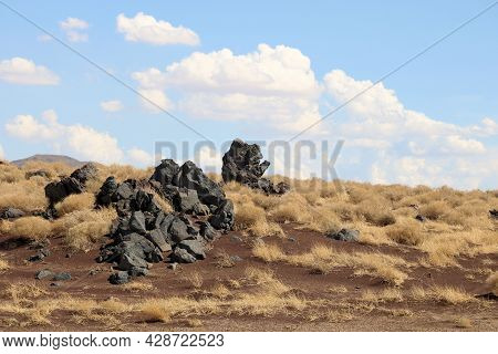 Lava Rocks On A Volcanic Field Surrounded By Sagebrush Taken On Arid Badlands At The Great Basin Des